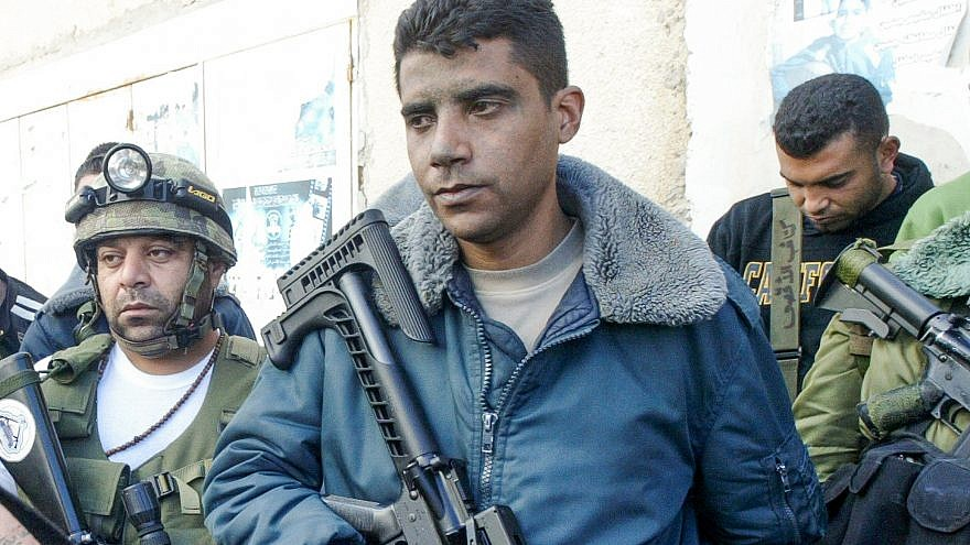File photo:  Zakaria Zubeidi, the West Bank leader of Palestinian militant group Al Aqsa Martyrs Brigades surrounded next to armed men in the West Bank city of Jenin, March 10, 2007. Credit: Nasser Ishtayeh/Flash90