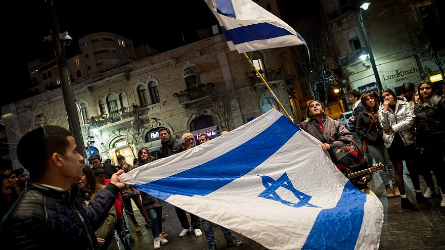 Crowds hold an Israeli flag as they gather in memory of 19-year-old Ori Ansbacher in Zion Square in Jerusalem on Feb. 9, 2019. The young woman was found dead two nights beforehand in Ein Yael, in the outskirts of Jerusalem, after she was raped and murdered by a Palestinian man. Photo Yonatan Sindel/Flash90.