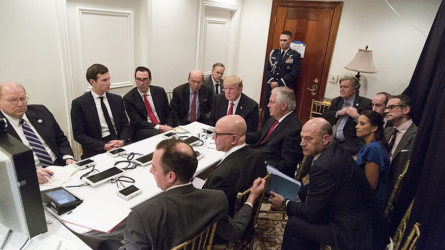 U.S. President Donald Trump receives a briefing on April 6, 2017 about a military strike on Syria from his National Security team, including a video teleconference with Secretary of Defense Gen. James Mattis and Chairman of the Joint Chiefs of Staff Gen. Joseph F. Dunford in a secured location at Mar-a-Largo in Palm Beach, Fla. Credit: Official White House Photo by Shealah Craighead.
