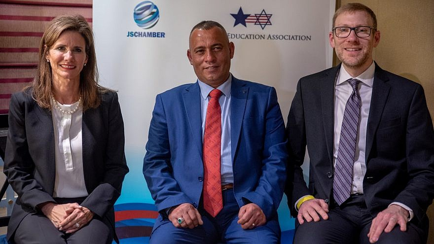 From left: Heather Johnston, founder and executive director of USIEA; Ashraf Jabari, a Palestinian business and community leader from Hebron; and Avi Zimmerman, co-founder of the JSC. Credit: Eitan Tal.