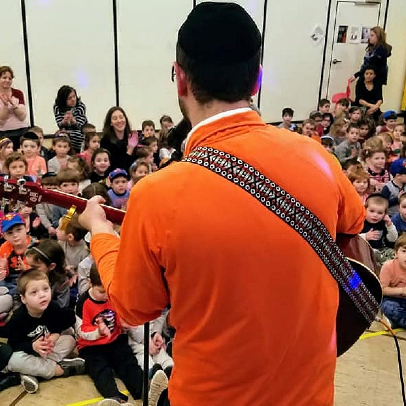 "Jake Czuper, aka ""Rabbi Jake,"" entertains fans at Anshei Lubavitch of Fair Lawn, N.J. Credit: Anshei Lubavitch of Fair Lawn, N.J."