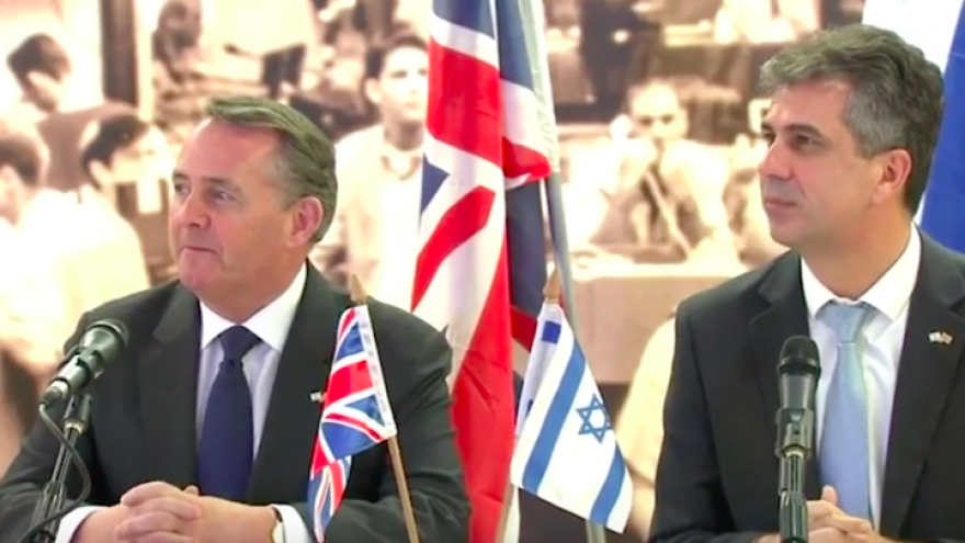 U.K. Secretary of State for International Trade Liam Fox (left) and Israeli Minister of Economy Eli Cohen address the media after signing a free trade agreement between the two countries on Feb. 18, 2019, ahead of the United Kingdom's expected split with the European Union in March 2019. Credit: Screenshot.