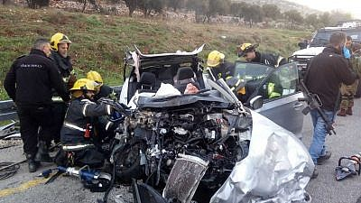 Firefighters extract victims from a fatal car accident in Samaria, near the community of Eli, on Feb. 19, 2019. Source: Israel Police.