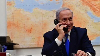Israeli Prime Minister Benjamin Netanyahu speaks to U.S. President Donald Trump over the phone on March 21, 2019, thanking him for the United States recognizing Israel's sovereignty over the Golan Heights. Credit: Kobi Gideon/GPO.