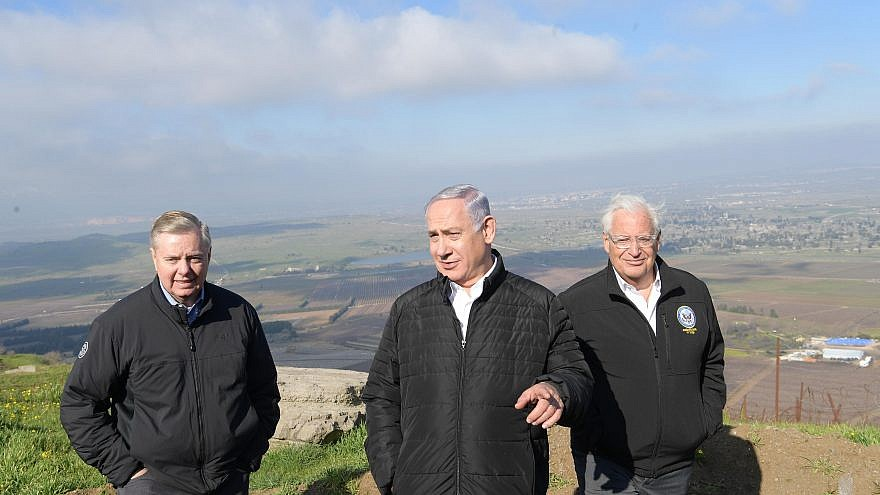 U.S. Sen. Lindsey Graham (left) with Israeli Prime Minister Benjamin Netanyahu and U.S. Ambassador to Israel David Friedman on the Golan Heights, March 11, 2019. Credit: Amos Ben-Gershom/GPO.