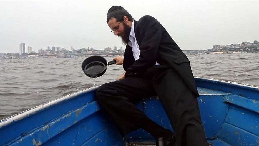 When Rabbi Arieh Raichman was growing up in Texas, he never imagined that he would be koshering pots and pans in Brazil's Amazon River. Credit: Chabad.org/News.