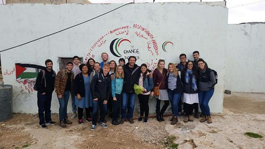 """A group of students on a visit last year to the Palestinian village of Jubbet ad-Dhib, sponsored by J Street U. According to J Street U, the students """"learned about life under occupation: the demolition orders, electricity and water issues, and more."""" Credit: J Street U via Twitter."""