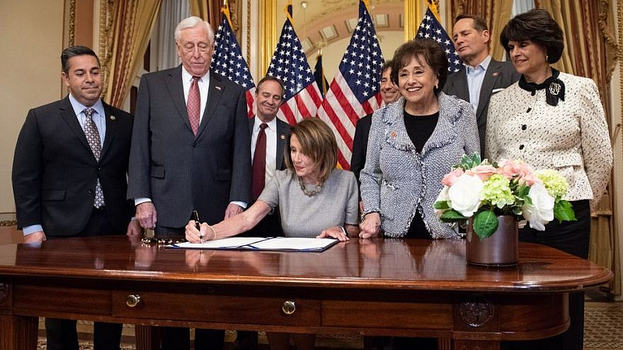 Speaker of the House Nancy Pelosi signs a bill along with Democratic House leadership on Jan. 25, 2019. Credit: Nancy Pelosi via Twitter.