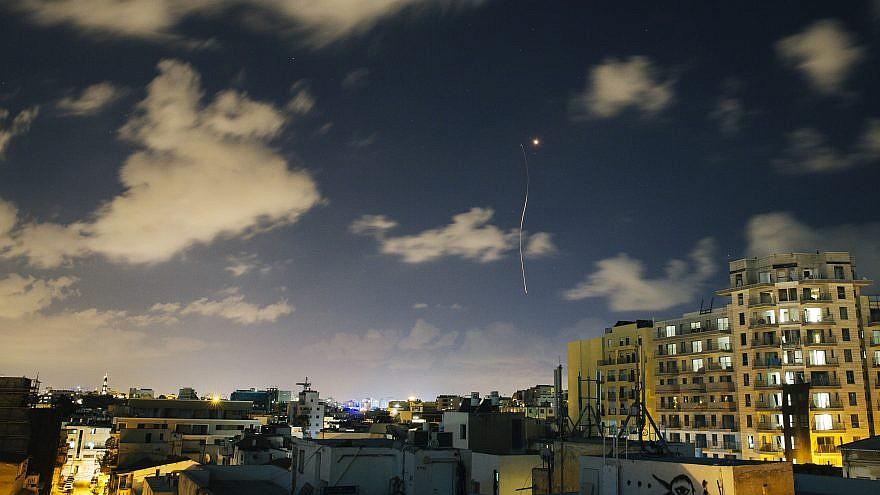 File photo: An Israeli Iron Dome interceptor rocket flies above the Tel Aviv skyline as seen from a rooftop on July 17, 2014. Credit: Matanya Tausig/Flash90.