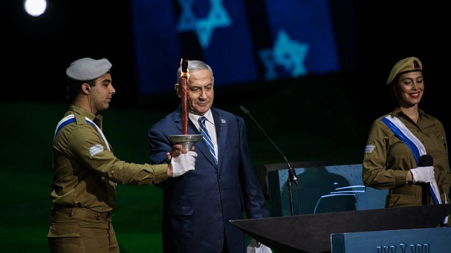 Israeli Prime Minister Benjamin Netanyahu lights a torch at the 70th anniversary Independence Day ceremony on Mount Herzl in Jerusalem, on April 18, 2018. Photo by Hadas Parush/Flash90.