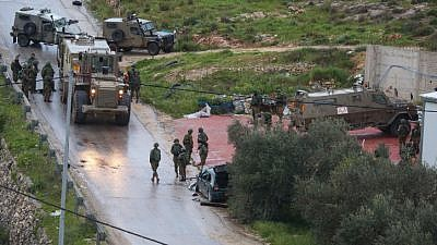 Israeli security forces at the scene where a Palestinian driver ran over soldiers in Mateh Binyamin in the West Bank on March 4, 2019. Two soldiers were wounded in the attack; the driver and one partner were killed. Photo by STR/Flash90.