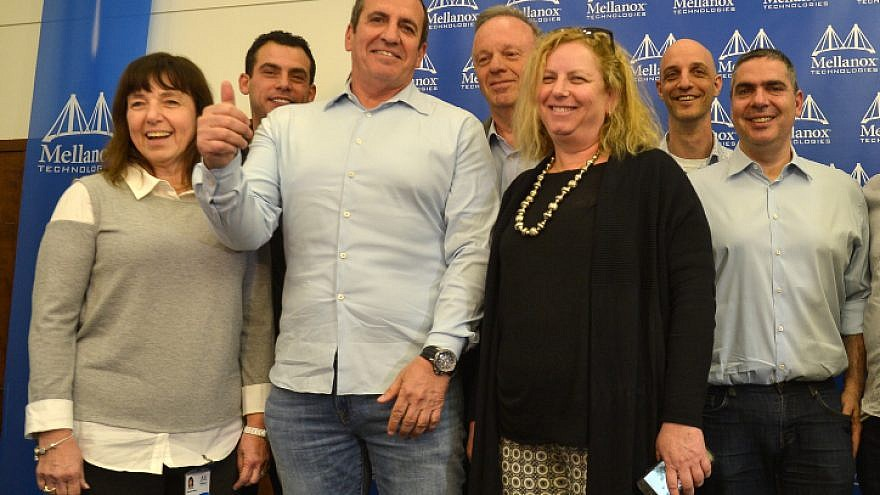 Eyal Waldman, president of Mellanox Technologies, with others at the company during a press conference in Tel Aviv on March 11, 2019. Photo by Flash90.