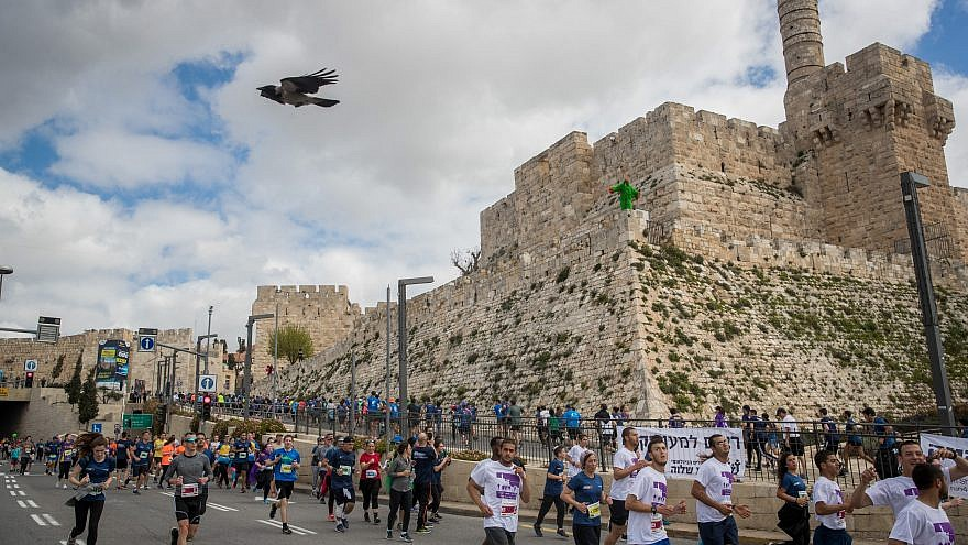 Thousands of runners take part in the 2019 international Jerusalem Marathon in the Old City on March 15, 2019. Credit: Yonatan Sindel/Flash90.
