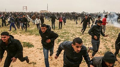 """Palestinian protesters take part in a """"Great March of Return"""" demonstration, near the Israel-Gaza border east of Rafah in the southern Gaza Strip, on March 30, 2019. Photo by Abed Rahim Khatib/ Flash90."""