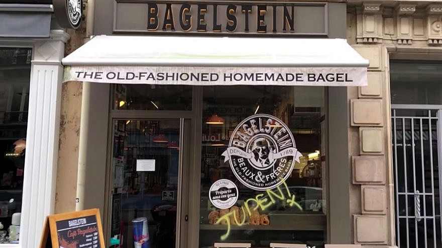 "The Paris bagel shop where the German word ""Juden"" (""Jews"") was spray-painted in yellow on the front door, February 2019. Credit: YouTube Screenshot."