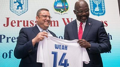 Mayor of Jerusalem Moshe Leon with Liberian President George Weah during a soccer event in Jerusalem on Feb. 27, 2019. Photo by Noam Revkin Fenton/Flash90.