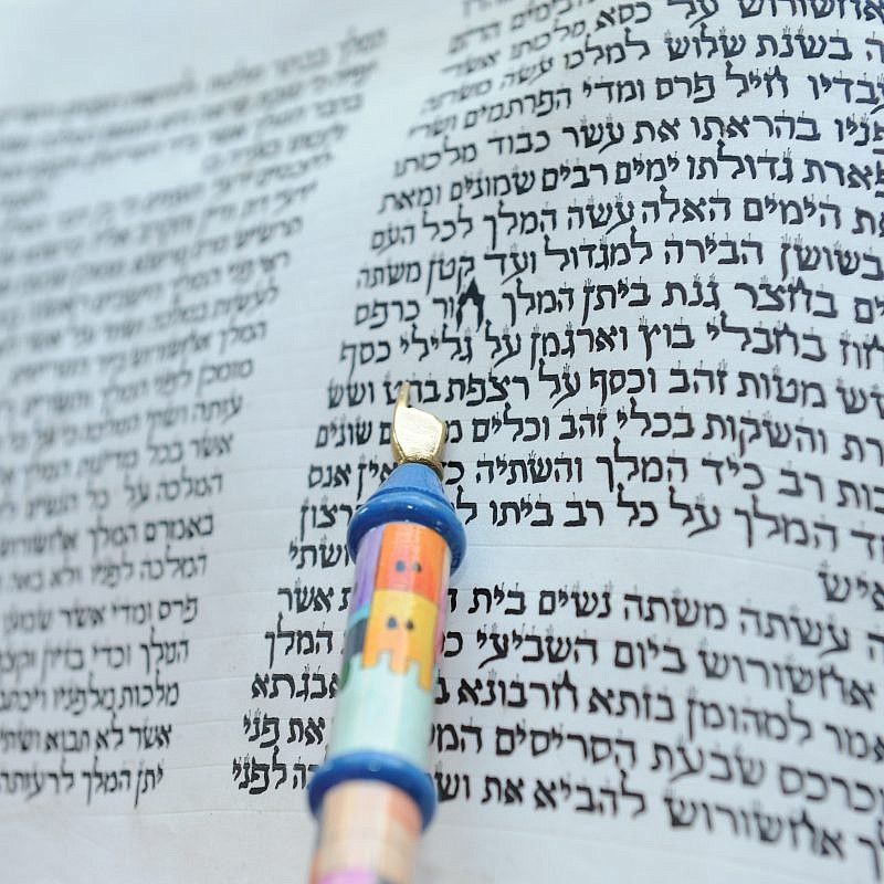 First chapter of a hand-written scroll of the Book of Esther, with reader's pointer, March 11, 2009. Credit: Chefallen via Wikimedia Commons.