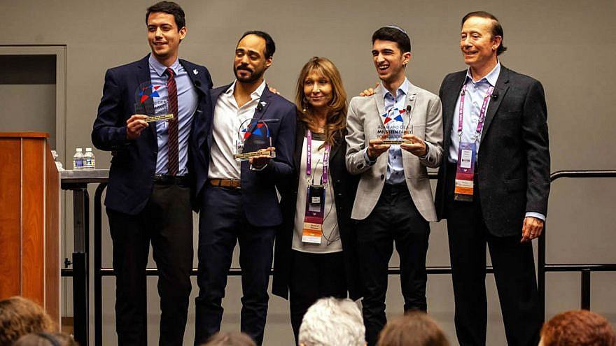 """Students from Baruch College in New York, who won the grand prize inn the second annualInnovation Competition for their project, """"Brave,"""" with Adam and Gila Milstein. Credit: Courtesy of Adam and Gila Milstein Family Foundation."""