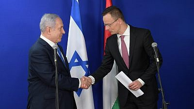 Israeli Prime Minister Benjamin Netanyahu with Hungarian Foreign Minister Peter Szijjarto in Jerusalem on March 19, 2019. Credit: Amos Ben-Gershom/GPO.