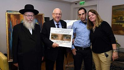 From left: Deputy Minister of Health and Knesset member Yaakov Litzman, Israeli President Reuven Rivlin, and participants in an event in Jerusalem to mark World Autism Awareness Day, sponsored by Rivlin, on March 24, 2019. Photo by Haim Zach/GPO.