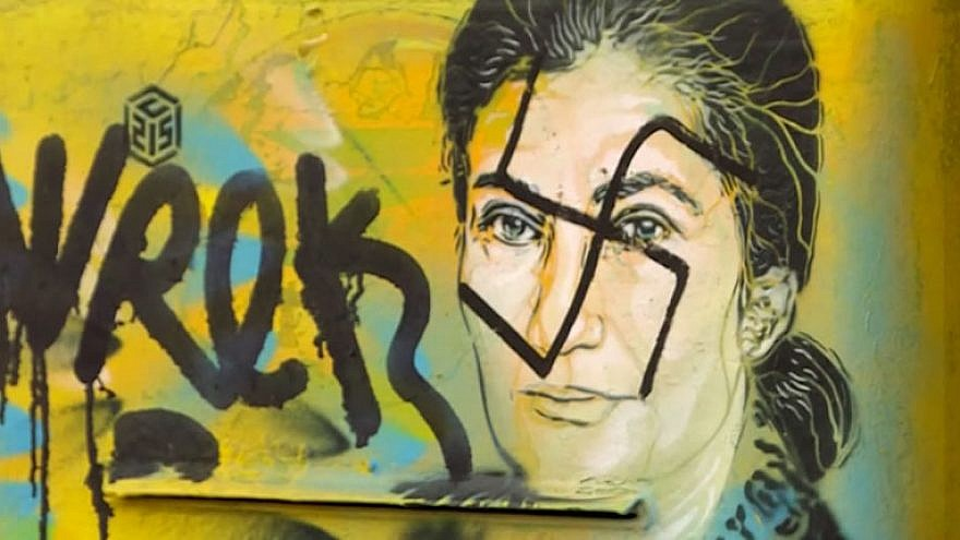 Swastika and graffiti scrawled on a portrait in Paris of the late Holocaust survivor Simone Veil, a French lawyer and politician who served as Minister of Health and a member of the Constitutional Council of France, February 2019. Credit: YouTube Screenshot.
