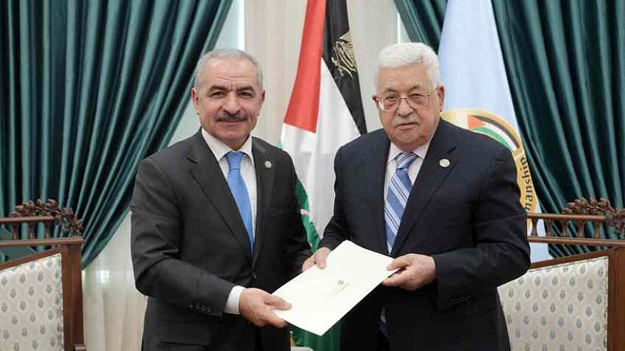 Mohammed Shtayyeh (left) accepts the position of prime minister of the Palestinian Authority and the duty to appoint a new government from leader Mahmoud Abbas (right). Credit: JCPA.