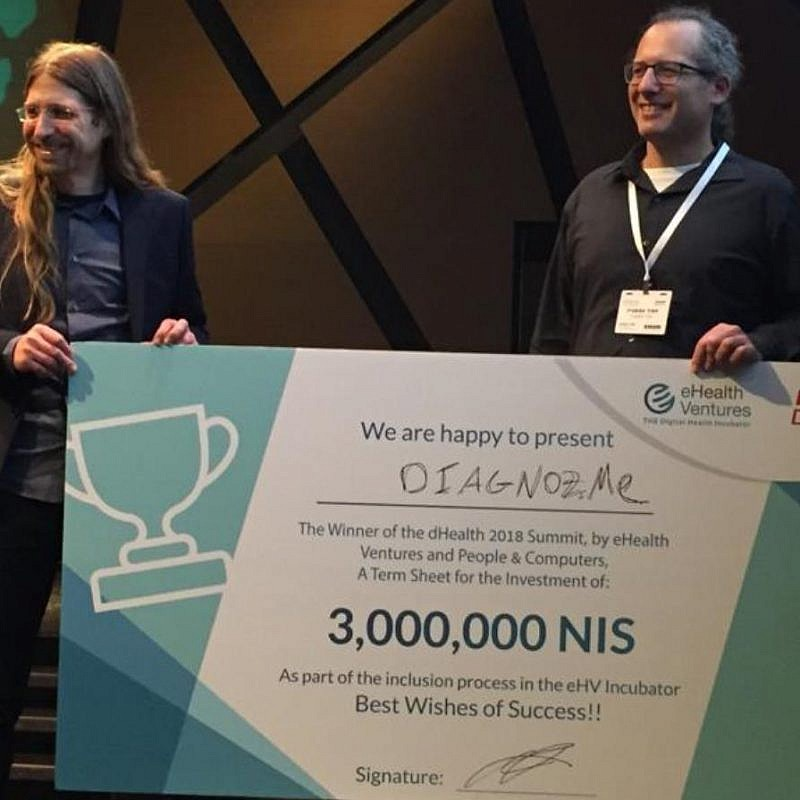 Diagnoz.me founders Ariel Livne and Tamir Epstein accepting their NIS 3 million (nearly $830,000) prize money at the dHealth 2018 Summit. Photo: Courtesy of Israel21c.