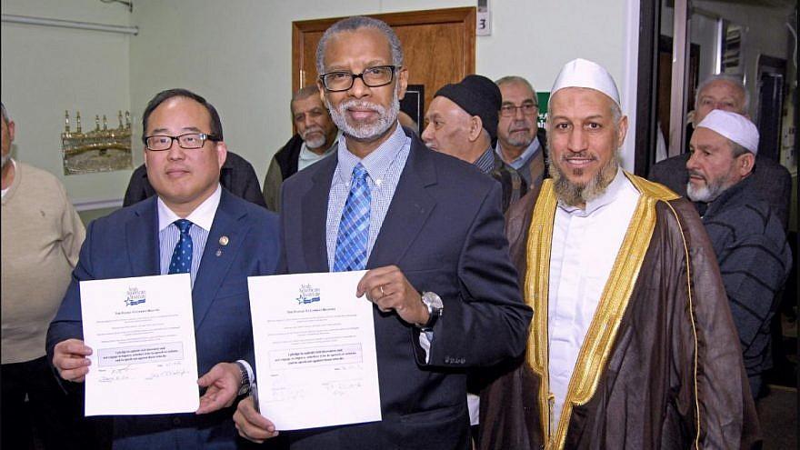 "At Al-Aqsa Islamic Society on Feb. 18, 2016, City Councilman David Oh (left) and State Senator Art Haywood (center) signed the Arab American Institute's ""Pledge to Combat Bigotry."" On right is Imam Shehata. (Phlcouncil.com, Feb. 23, 2016) (MEMRI)"