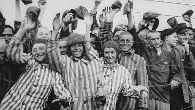 Survivors at the Dachau concentration camp cheer their liberation by U.S. soldiers. Credit: United States Holocaust Memorial Museum, Courtesy of National Archives and Records Administration, College Park, Md.