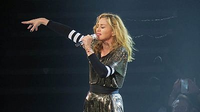 Madonna performing during her MDNA Tour 2012 at Key Arena in Seattle. Credit: Ronald Woan/Wikimedia Commons.