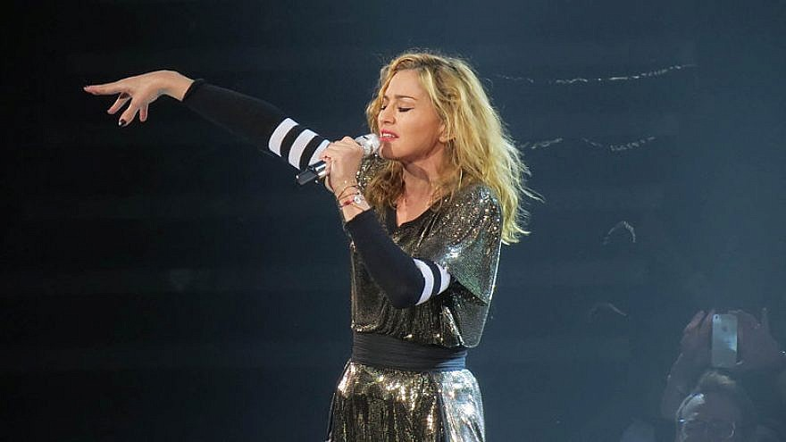 Madonna performing during her MDNA Tour 2012 at Key Arena in Seattle. Credit: Ronald Woan via Wikimedia Commons.