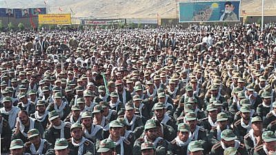 Iran's Islamic Revolutionary Guard Corps with a billboard of Supreme Leader Ayatollah Ali Khamenei in the background. Credit: Wikimedia Commons.
