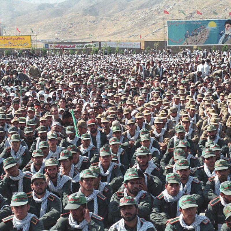 Iran's Islamic Revolutionary Guard Corps with a billboard of Supreme Leader Ayatollah Ali Khamenei in the background. Credit: Wikimedia Commons.