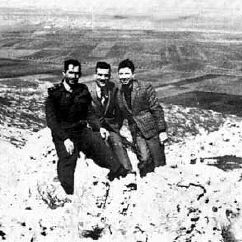 Eli Cohen (in the middle) posing as Arab merchant Kamel Amin Thaabet, with his friends from the Syrian army on the Golan Heights overlooking Israel, mid-1960s. Credit: Syrian military personnel photo via Wikimedia Commons.