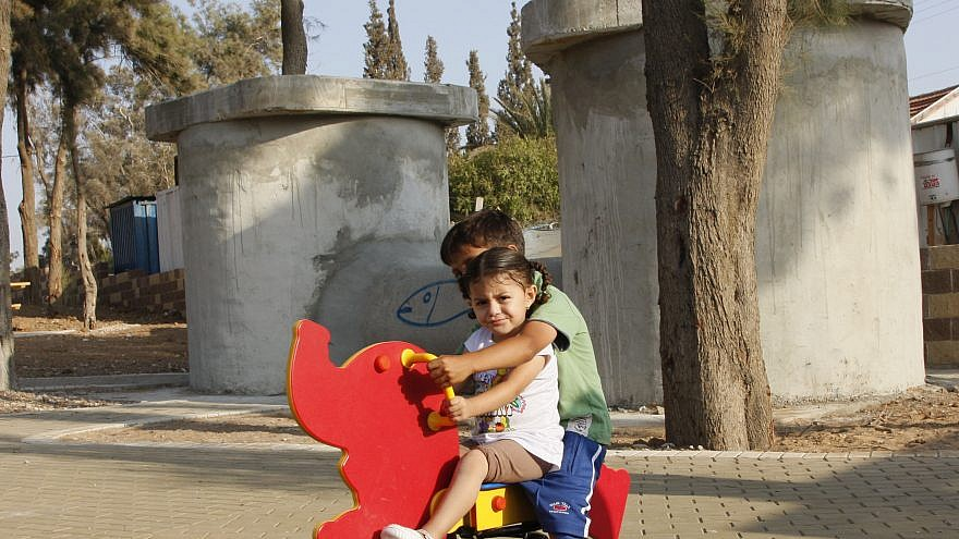 Children play outside in Sderot, which also has an enormous underground concrete recreational area with three bomb shelters for protection from regular rockets launched by Hamas in the neighboring Gaza Strip. Photo by Daniel Dreifuss/Flash90.