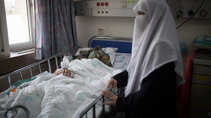 Sojud, 16, recovers with her mother by her side after going through a cardiac catheterization at the Wolfson Medical Center in the central Israeli city of Holon on April 11, 2018. The Palestinian girl, from the West Bank city of Nablus, was suffering from heart problems, and with the financial and logistical support of the Israeli nonprofit NGO Save a Child's Heart was able to receive this life-saving procedure in an Israeli hospital. Photo by Hadas Parush/Flash90.
