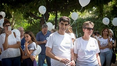 Leah and Simcha Goldin, the parents of late IDF Lt. Hadar Goldin, whose body is being held by Hamas in Gaza, attend a rally outside of Israel's Ministry of Defense in Tel Aviv on Aug. 31, 2018, calling on the government to do more to return the bodies of Goldin and IDF soldier Oron Shaul. Credit: Miriam Alster/Flash90.