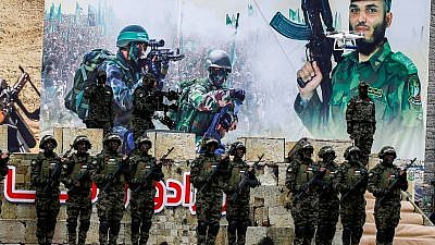 Palestinian members of the Al-Qassam Brigades, the armed wing of Hamas, at a rally in Gaza City celebrating the 31st anniversary of Hamas on Dec. 16, 2018. Credit: Abed Rahim Khatib/Flash90.