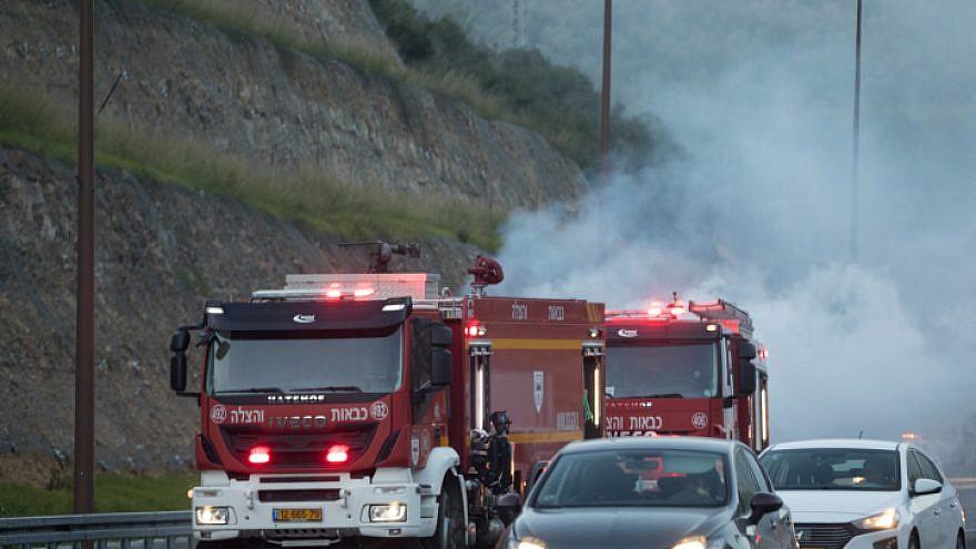 Firefighters on Highway 1 near Latrun, Jan. 21, 2019. Photo by Yonatan Sindel/Flash90.