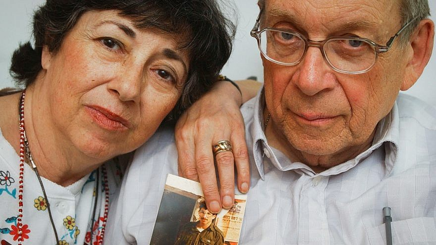 Miriam and Yoni Baumel hold a picture of their son, Zachary Baumel, who went missing in the Battle of Sultan Yacoub in 1982, in Jerusalem on July 7, 2003. Photo by Flash90.