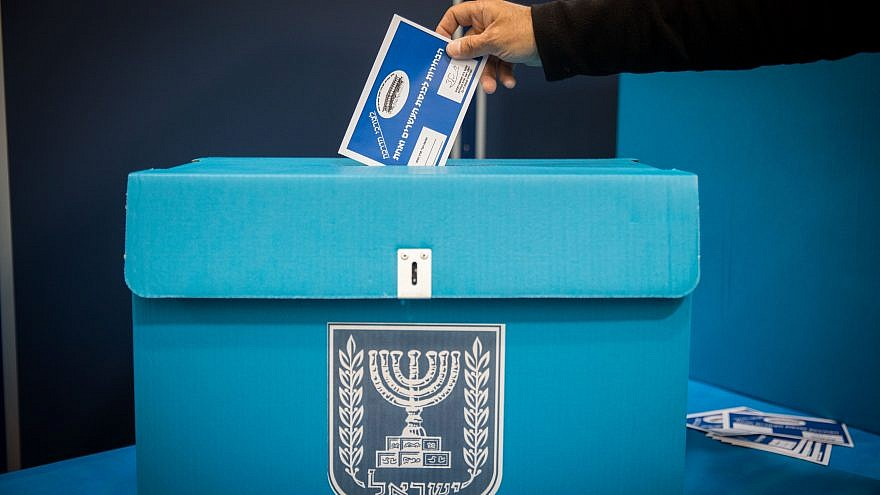 A man casts his vote at the central elections committee warehouse in Shoham on March 25, 2019. Credit: Noam Revkin Fenton/Flash90.