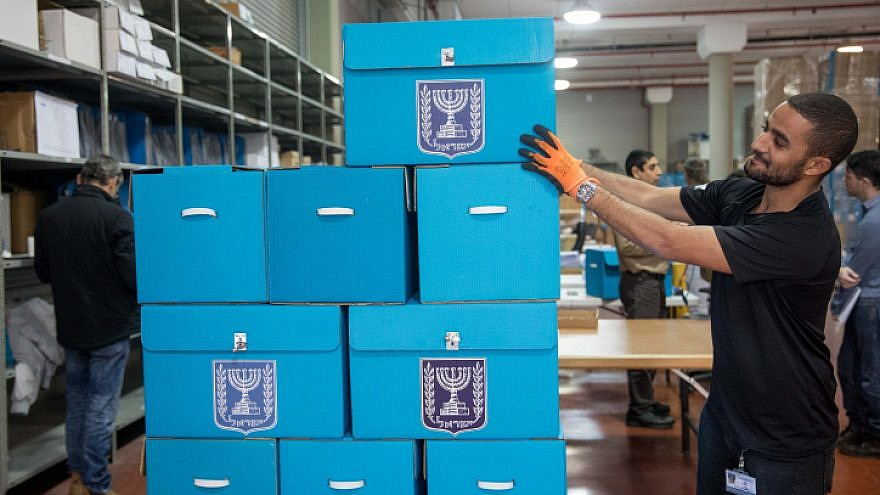 Workers prepare ballot boxes for the upcoming Israeli election at a central elections committee warehouse in Shoham before they are shipped to polling stations, March 25, 2019. Photo by Noam Revkin Fenton/Flash90.