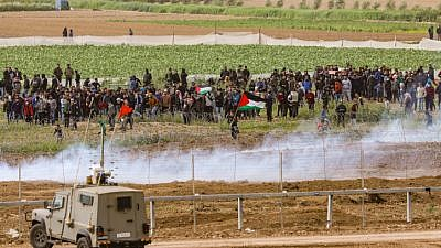 Israeli security forces clash with masses of Palestinian protesters, as seen from the Israeli side of the border with Gaza on March 30, 2019. Credit: Noam Revkin Fenton/Flash90.