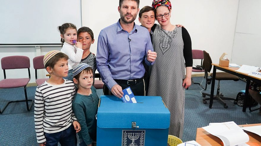 Head of the National Union Party Bezalel Smotrich casts his ballot, with his family in tow, at a voting station in the Judea town of Kedumim on April 9, 2019. Photo by Hillel Maeir/Flash90.