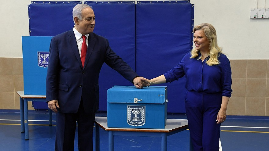 Israeli Prime Minister Benjamin Netanyahu and his wife Sara cast their vote at a polling station in Jerusalem during the Knesset Elections, on April 9, 2019. Credit: Haim Zach/GPO