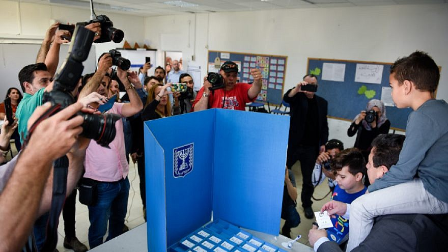 Israeli-Arab parliament member Ayman Odeh casts his ballot at a voting station in Haifa during Israel's national elections on April 9, 2019. Photo by Meir Vaknin/Flash90.