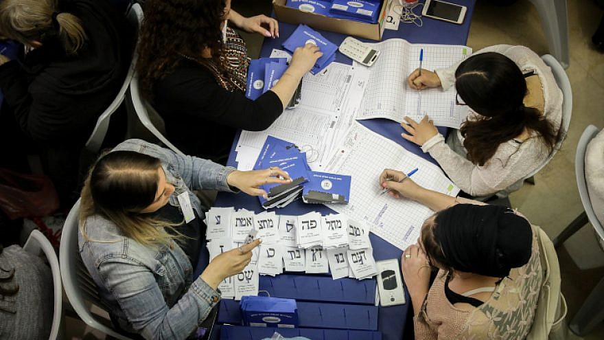 The ballots of soldiers and absentee voters are counted the day after national elections, on April 10, 2019. Photo by Noam Revkin Fenton/Flash90.