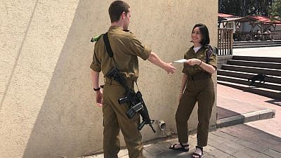 Ahead of Passover, the International Fellowship of Christians and Jews is sponsoring gift coupons of $139.12 for 8,500 Israeli lone soldiers and soldiers from low-income families. Credit: IDF Spokesperson's Unit.
