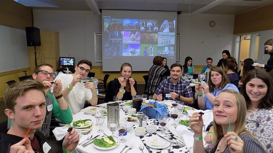 Students at the University of Utah's Hillel celebrating a Passover seder. Credit: Courtesy.