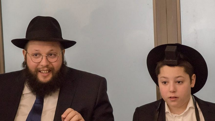 Rabbi Shalom Ber Stambler, chief rabbi of Chabad in Poland (pictured with his son Yossi), will host a special Passover seder with the families of ghetto survivors from Israel, Europe and the U.S. Picture by Muzeum Getta Warszawskiego. (EJP)